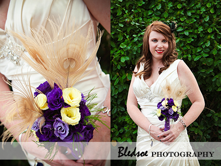 """Bride holding a peacock feather and purple rose bouquet"""