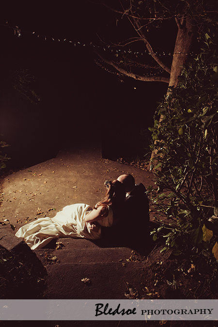 """Bride and groom snuggle in the moonlight"""