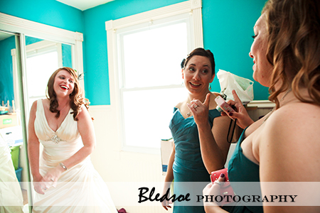 """Bride laughing with her bridesmaids"""