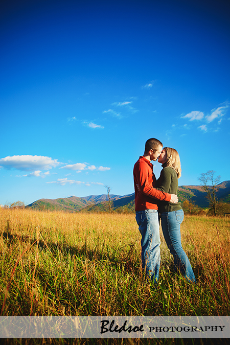 """Fall engagement photos under a blue sky in Cades Cove"""