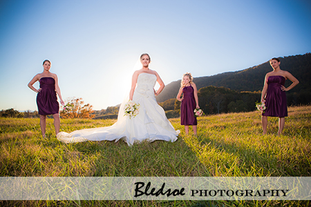 Bride with her bridesmaids on the hill at sunset at The Stables in LaFollette, TN