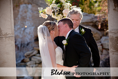 Bride and Groom kissing.  You may kiss the bride!