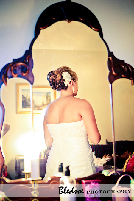 Bride's reflection in mirror.