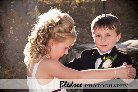 Flower girl and ring bearer dancing.