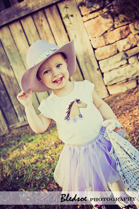 """Allie in her purple cowboy hat and tutu"""