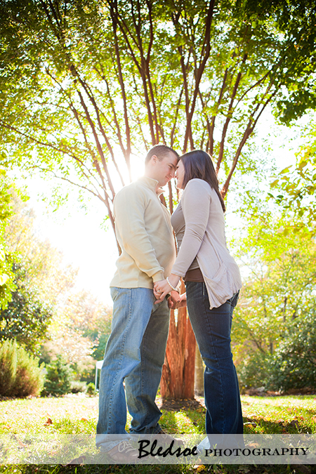 """Amy and Scott in front of a sunlit tree at UT Gardens"""