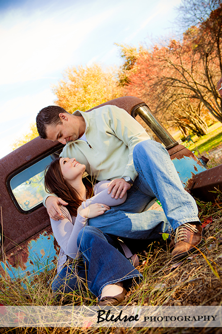 """Amy and Scott cuddle in the back of a vintage truck at UT Gardens"""