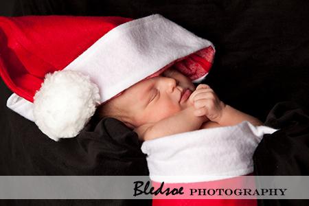 """Newborn Santa baby in a Santa Hat"""