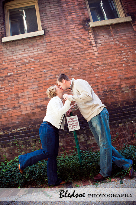 """Kissing in front of a No Loitering sign"""