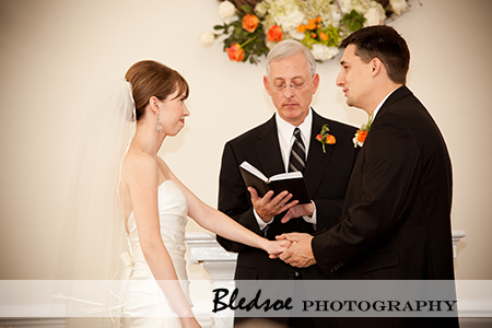 """Couple reciting vows during the wedding ceremony"""