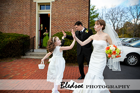 """Bride gives high five to her flower girl"""