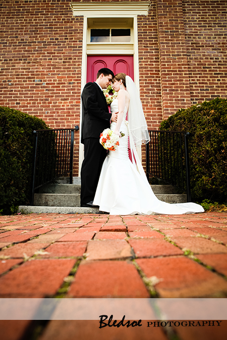 """Bride and groom outside of Owens Chapel Church of Christ"""