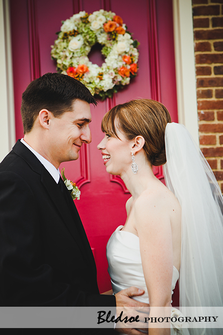 """Bride and groom laughing"""
