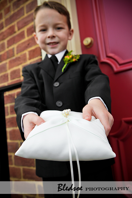 """Ring bearer holding ring pillow"""