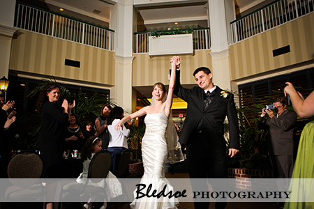 """Bride and groom entering the reception at Hilton Suites Brentwood"""