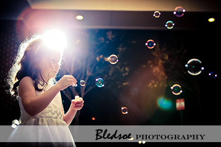 """Flower girl blowing bubbles"""