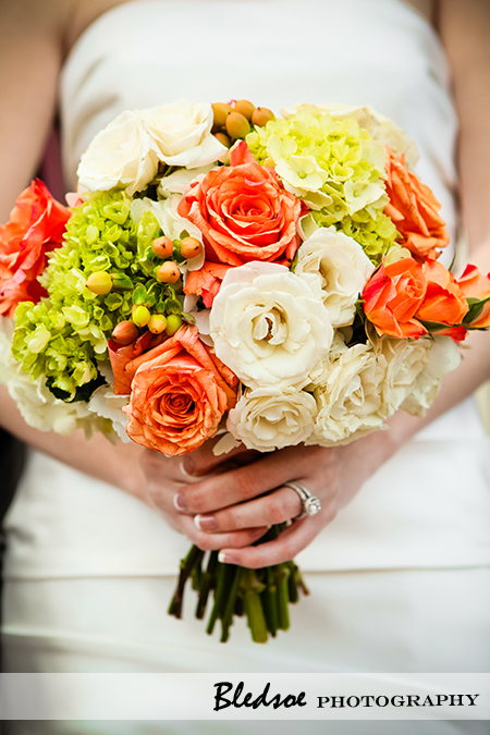 """Bridal bouquet of white roses, orange roses, green hydrangea"""