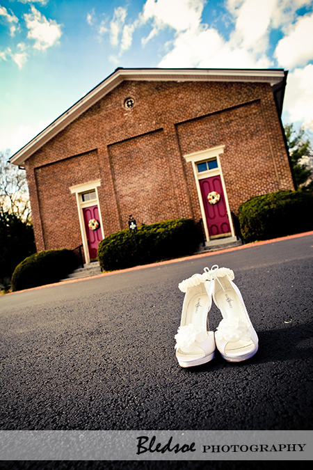 """Wedding shoes in front of Owens Chapel Church of Christ"""