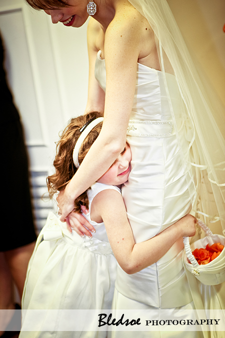 """Flower girl hugging bride"""