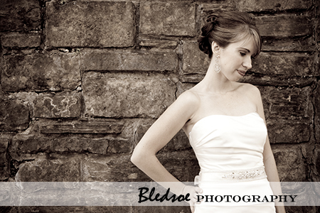 """Bride in front of stone wall at Cheekwood Botanical Gardens"""