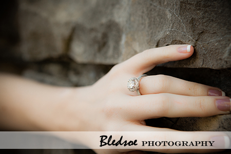 """Engagement Ring against stone wall"""