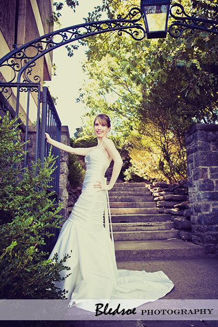 """Bride under stone arch at Cheekwood Botanical Gardens"""