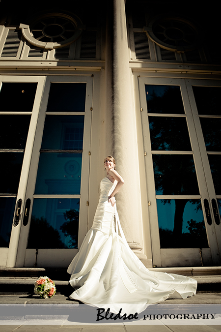 """Bride in front of the columns of the Cheek Mansion at Cheekwood Botanical Gardens"""